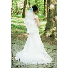 The wedding veil is embroidered with a dressing room №38